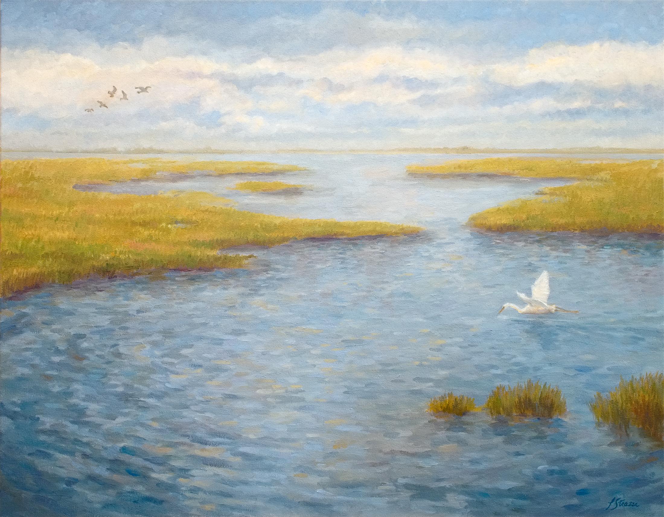Birds flying over the marsh